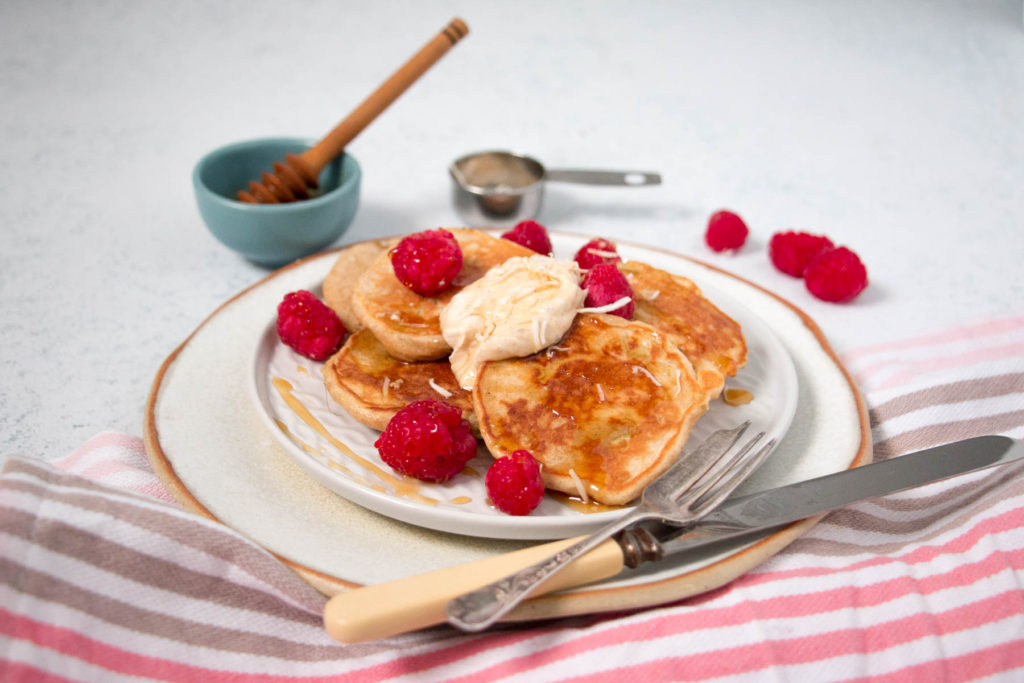 cinnamon yoghurt pikelets topped with honey and raspberries