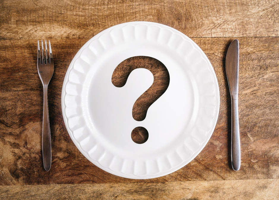 What'd the difference between good and bad fats question mark on plate with knife and fork
